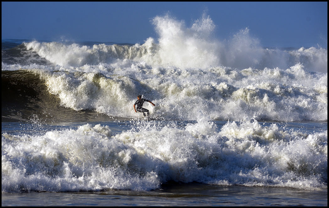 A surfer braves the big waves at Outer Cabrillo Beach in San Pedro on Wednesday.